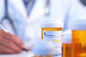 doctor and prescription bottle